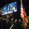 Reflections: A jumbo screen in Hulman Center displays a video image of students receiving diplomas during Sunday's Commencement for Terre Haute South.