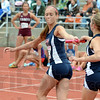 Third leg: North's #622 Emily Cotterman takes the baton from Jessi Conley during Friday's 3200 Relay event at the State Finals.