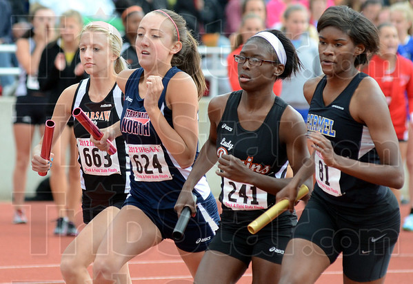 First leg: North's #624 Sydney Dickerson starts the 3200 Relay during Friday's Track and Field State Finals.