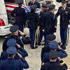 Tribune-Star/Joseph C. Garza<br /> Commissioned salute: Air Force and Army officers salute as the body of the late Indiana National Guard Spc. Arronn D. Fields is loaded into a hearse Friday at the Terre Haute International Airport-Hulman Field.
