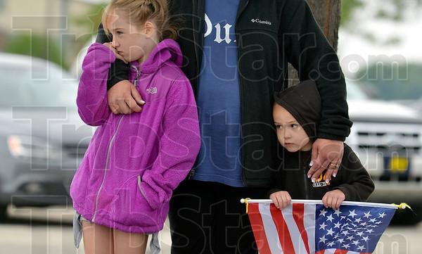 Tribune-Star/Joseph C. Garza<br /> Paying respects to the soldier: Abigail and Matthew Ewing watch with their mother, Kelly, as a procession of Patriot Guard riders pass by at the Terre Haute International Airport-Hulman Field on their way to Brazil as they lead the hearse carrying the body of the late Indiana National Guardsman Spc. Arronn Fields.