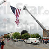 Tribune-Star/Joseph C. Garza<br /> For Spc. Fields: The body of the late Indiana National Guard Spc. Arronn Fields passes under a giant flag Friday in Brazil.