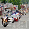 Tribune-Star/Joseph C. Garza<br /> Riding for one who gave all: Law enforcement and Patriot Guard riders lead the hearse carrying the body of the late Indiana National Guard Spc. Arronn D. Fields Friday in Brazil.