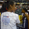 Tribune-Star/Joseph C. Garza<br /> Title T-shirt: A young WNBA fan wears a Title IX T-shirt that was handed out during the Indiana Fever's game against the Connecticut Sun Thursday in Indianapolis.