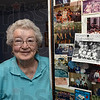 Tribune-Star/Jim Avelis<br /> Memories: Levon Garrison stands with some of the photographs she has accumulated over the years as a golfer as well as bowler.