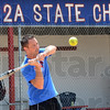 Tribune-Star/Jim Avelis<br /> Return engagement: South Putnam softball coach Chris Jones hits flyballs to his outfielders in front of their dugout. The Eagles hope to repeat as state champs today.