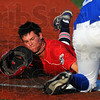 Tribune-Star/Jim Avelis<br /> Too fast: Dubois County base runner Landon Curry slides safe into third base before Terre Haute Rex defender Nick Johnson can apply the tag. Curry played his freshman year of college baseball at Indiana State University.
