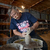 Potter: Walt Schmidt works on a piece during the Clay City Pottery Festival Saturday afternoon.