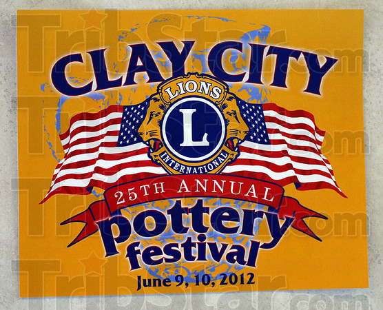 Poster: Detail photo of poster for Clay City Festival.