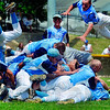 Tribune-Star/Joseph C. Garza<br /> Flyin' to state: Shakamak's Luke Sweet, right, shows off his high jump skills as fellow teammate Kyler Fulford, left, tumbles head-over-heels on a pile of teammates after the Lakers defeated South Central in the Jasper Class A semistate game Saturday.