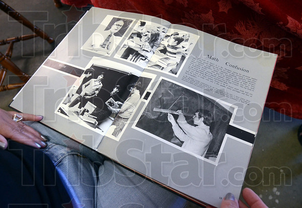 Memories: A reunion committe members looks at a 1972 South yearbook during Sunday's organizational meeting.