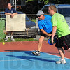 Tribune-Star/Jim Avelis<br /> Family gathering: Mike Lawler and his son Scott play a game of pickle ball with Mike Effner and his son Jack at Brittlebank park Friday morning. In the background Nancy Effner chats with Rex Lawler, Mike's dad.