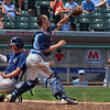 Too much LCC: Shakamak catcher Dylan Collins catches the throw to homeplate too late as Lafayette Central Catholic's Nick Stone slides to score during the teams' Class A state championship game Saturday in Indianapolis.