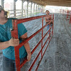 Tribune-Star/Jim Avelis<br /> Strong fences: Neighbors and fellow 4-Hers Elizabeth Romine and Mckala Dudley carry sections of fence that will corral their cattle during the upcoming Vigo County fair.