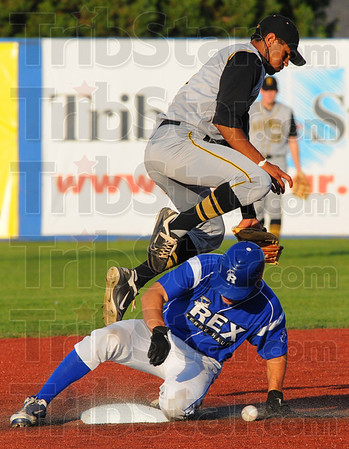Tribune-Star/Jim Avelis<br /> In safe: Terre Haute Rex base runner Kyle Kempf is safe at second base as Hannibal shortstop Kris Goodman can't come up with the throw. Kempf went on to score the second run of the game for the Rex.