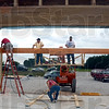 Framers: Carpenters for Christ volunteers work at the construction site of the Crossroads Baptist Church Monday afternoon.