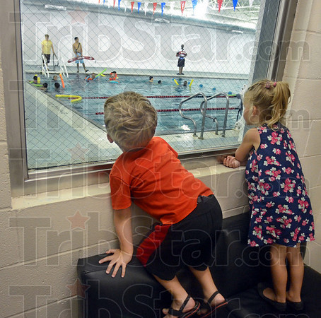Wanna join: Caleb Burch (3) and sister Emmalynn Burch watch activities in the YMCA pool during the first day of operation Monday.  They're checking out the new facility for possible membership.