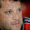 Tony Stewart stands in the garage during practice for the NASCAR Sprint Cup Series auto race at Pocono Raceway, Friday, June 8, 2012, in Long Pond, Pa. (AP Photo/LAT, Scott LePage) MANDATORY CREDIT