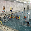 On guard: YMCA lifeguards watch a group of young kids during Monday's first day of operation for the facility at Fairbanks Park.