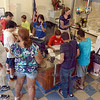 All hands on deck: The front desk of the YMCA is a hub of activity Monday afternoon on its first day of operation.