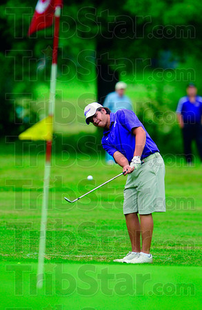 Tribune-Star/Joseph C. Garza<br /> Contender: Sullivan's Nathan Pirtle chips towards the third hole of the Phil Harris Golf Course Monday during sectional action in Linton.