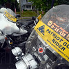 Riders:Rain covered  Patriot Guard Rider motorcycles sit in the parking lot of the Moore Funeral Home in Brazil.
