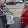 God Bless: Bob Nance of Brazil holds a poster of Spc. Arronn Fields after visitation at the Moore Funeral home Monday afternoon. Bob and his wife Joanne are friends of the parents of Spc. Fields.