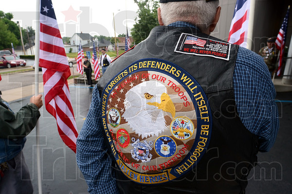 Patriot: Volunteers and members of the Patriot Guard Riders form a gauntlet of Flags at the Moore Funeral Home in Brazil as they honor fallen son Arronn D. Fields.