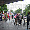 """Army family: Sgt. Nicholas Shaw (maroon shirt) greets members of his Army family at visitation Monday. Shaw is in the same unit as Spc. Arron D. Fields and described himself as a """"hunting and fishing buddy"""" ."""