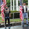 Support: Two Patriot Guard Riders stand in the rain at the entrance to the Moore Funeral Home to honor Spc. Arronn D. Fields Monday afternoon.