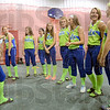 Lady Rex: Members of the Lady Rex squad meet in the Miss Softball facility as they prepare for World Series play.