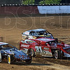 """Hot laps: Several cars participate in """"hot laps"""" prior to the evening of racing at the fairgrounds Tuesday evening."""