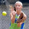 Center: Lady Rex outfielder Natalie Draper fields hit ball during Monday's short workout.