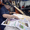 Tribune-Star/Jim Avelis<br /> Constant checking: Tribune-Star pressman John Hoff checks for proper registration during a recent printing run. Hoff retires Thursday after 43 years on the job.