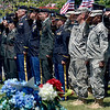 Tribune-Star/Joseph C. Garza<br /> For a fellow soldier: U.S. Army soldiers render a salute as the casket of Spc. Arronn Fields is carried from the hearse to his grave site Tuesday at Clearview Cemetery.