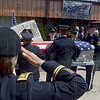 Tribune-Star/Joseph C. Garza<br /> A salute for a fallen soldier: U.S. Army Major Jesse Carlton salutes as the casket of Spc. Arronn Fields is loaded into a hearse outside of the Church of the Nazarene Tuesday after services inside the church in Brazil.