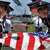 Tribune-Star/Joseph C. Garza<br /> An honor: Members of an honor guard work in unison as they prepare to ceremoniously fold the flag during the graveside military ceremony for Spc. Arronn Fields Tuesday at Clearview Cemetery near Brazil.
