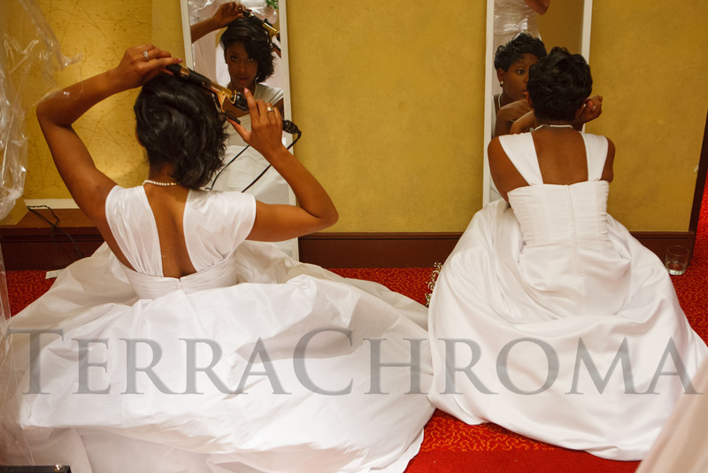 Kimberly Turner and Jaliah Peters make final touch-ups.  The 61st Annual Owl Club of Denver Debutante Cotillion at the Denver Marriott City Center near Denver, Colorado, on Saturday, June 2, 2012.<br /> Photo Steve Peterson