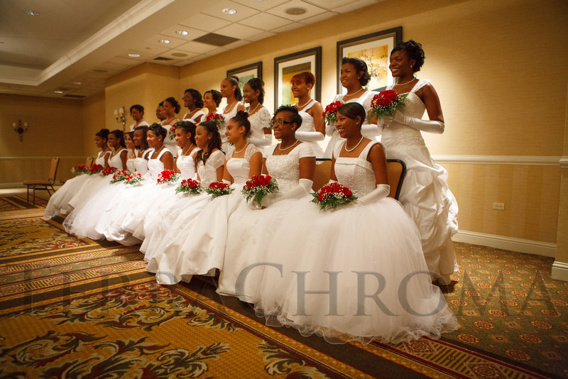 The debutantes gather for a formal group photo.  The 61st Annual Owl Club of Denver Debutante Cotillion at the Denver Marriott City Center near Denver, Colorado, on Saturday, June 2, 2012.<br /> Photo Steve Peterson