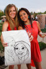 Maisie Roberts and Melody Mendez with their caricature.  Janet's Camp, benefiting the YMCA of Metropolitan Denver, at the home of Steve and Nikki Lockton in Englewood, Colorado, on Saturday, June 23, 2012.<br /> Photo Steve Peterson