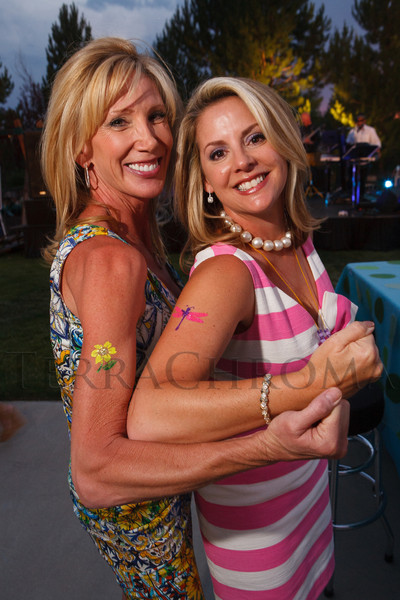 Janet Elway and Jane Buckley show off their body art.  Janet's Camp, benefiting the YMCA of Metropolitan Denver, at the home of Steve and Nikki Lockton in Englewood, Colorado, on Saturday, June 23, 2012.<br /> Photo Steve Peterson