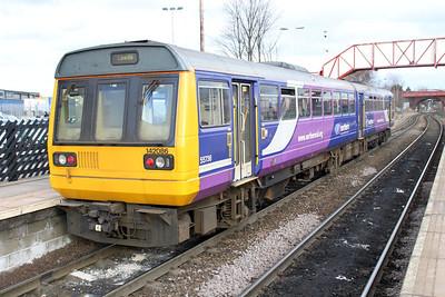 142086 at Knottingley on a Leeds service.