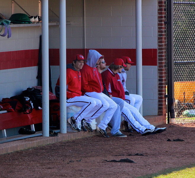 Players watch from the dugout