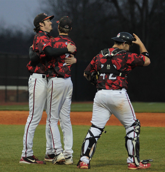 Pitcher, Brock Wilson, congratulates other pitcher, Stephen Gilmore for the game wining pitch. Giving a Win for The Runnin Bulldogs, 8-2