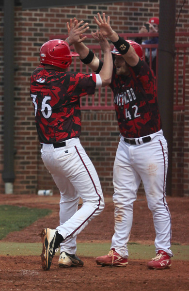 Number 42, John Harris and number 36, Brantley Smith celebrate the final two runs for Gardner-Webb putting the score to 8-2