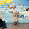 Tribune-Star/Joseph C. Garza<br /> Art discussion: Indiana State art major Jane Thornberry and professor emeritus David Erickson discuss the painting of the new mural at the Terre Haute Children's Museum Thursday.