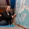 Tribune-Star/Joseph C. Garza<br /> A new museum mural: Indiana State junior art major Jane Thornberry paints the blue water around a fish on the new mural at the Terre Haute Children's Museum Thursday. The mural is a part of the Gilbert Wilson Memorial Mural project.