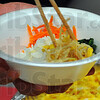 Tribune-Star/Jim Avelis<br /> Seoul food: One of the tables that offered food at the Food for Thought event at Rose-Hulman offered Korean food, several vegetables over rice with spices for added zest.