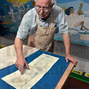 Tribune-Star/Joseph C. Garza<br /> From pencil to paint: Indiana State professor emeritus David Erickson shows the sketch of the new mural at the Terre Haute Children's Museum Thursday. The mural is part of the Gilbert Wilson Memorial Mural Project.
