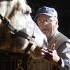 Tribune-Star/Jim Avelis<br /> Easy now: Tom Lytle was one of the volunteers at The Mane Event at St. Mary-of-the-Woods. On Wednesday differrent organizations gave presentations on incorporating horses in working with troubled youth and using them in team building exercises.